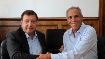 Alberto Weretilneck y Alejandro Caldarelli firmaron el convenio.