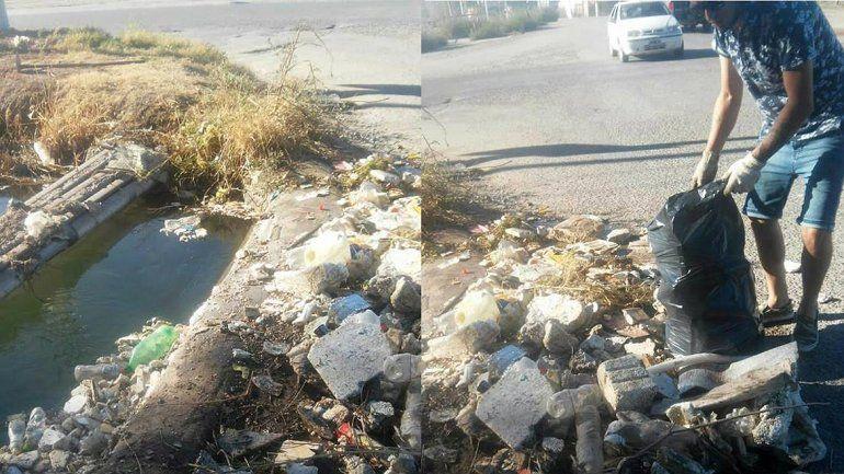 Dos jóvenes limpiaron un canal que estaba a punto de desbordarse