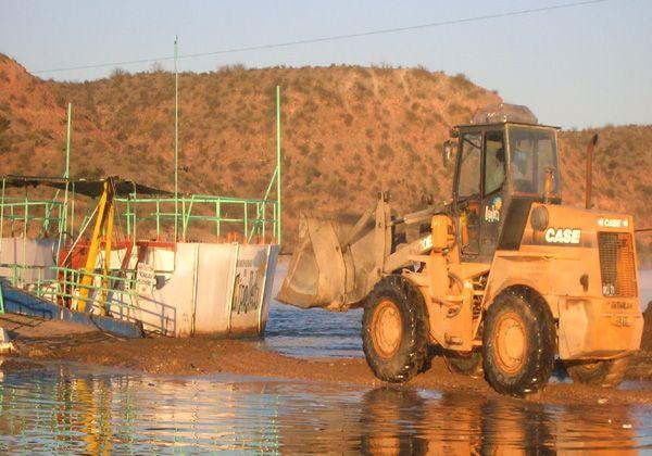 Trabajos en el muelle de la balsa de la Isla Jordán